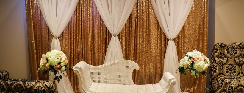 A classic gold and white decor for an intimate home wedding reception.